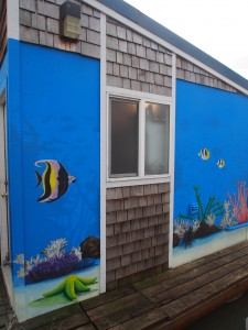 Tropical fish art on storage/shower building - tropical art nearing completion.