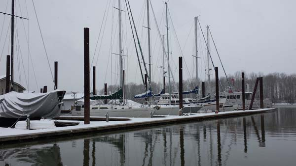 Sailboats covered with snow.  St. Helens Marina Winter