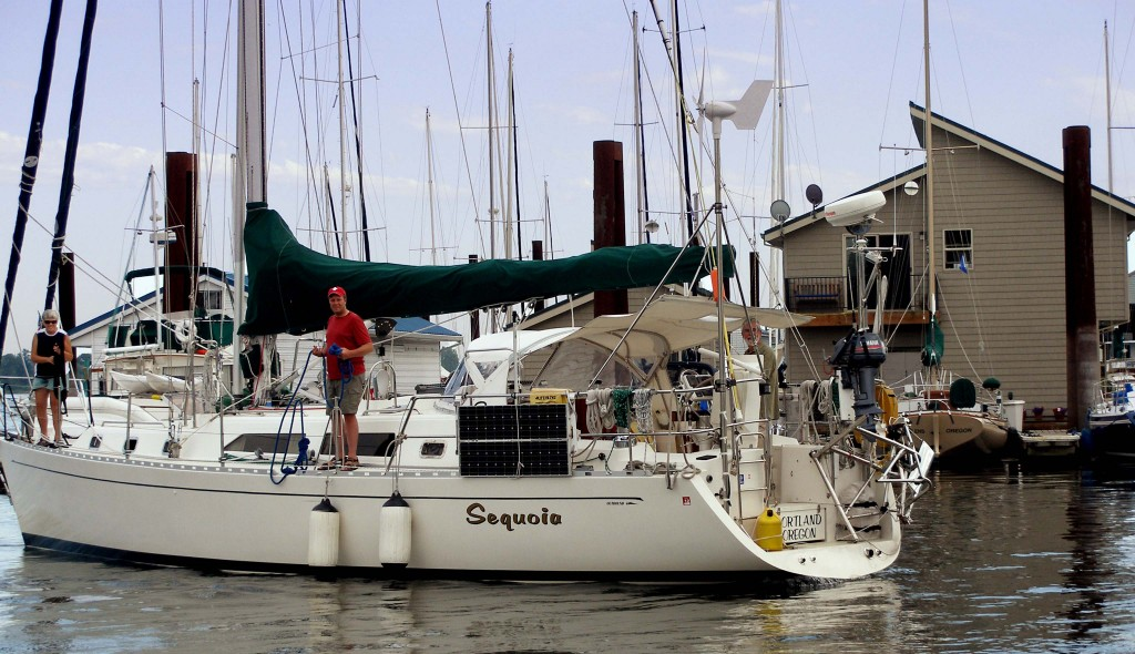 A sailboat arriving at St. Helens Marina, looking for transient moorage.