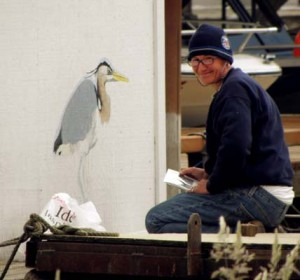 Toni working on heron mural at St. Helens Marina - Public Art