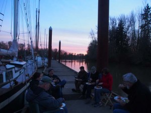 Friends having sunset potluck